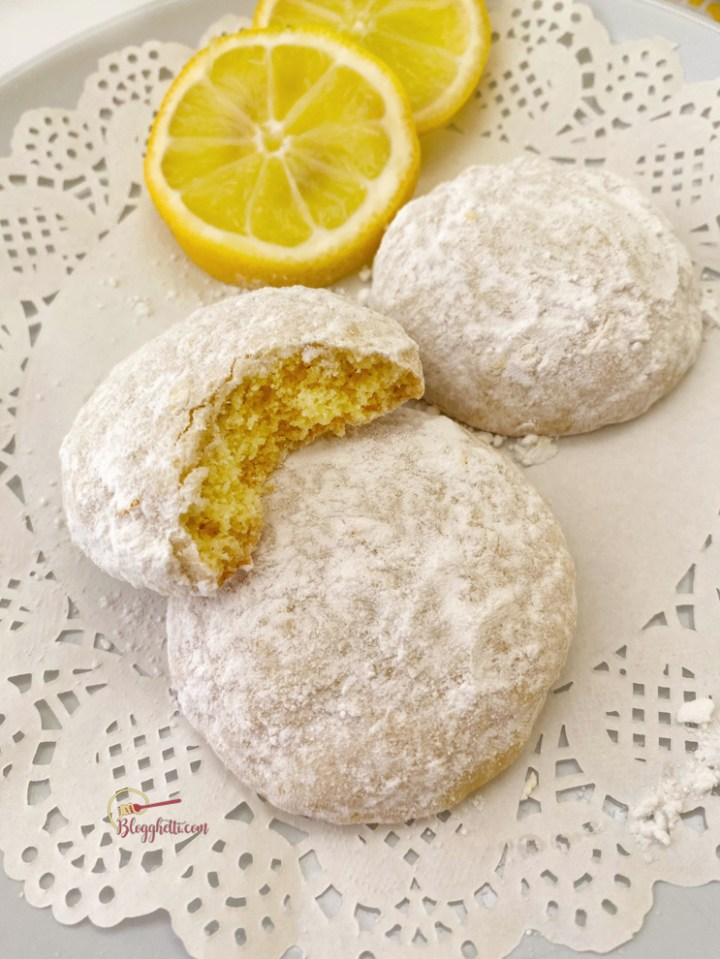 plate of lemon cooler cookies with a bit taken out of one