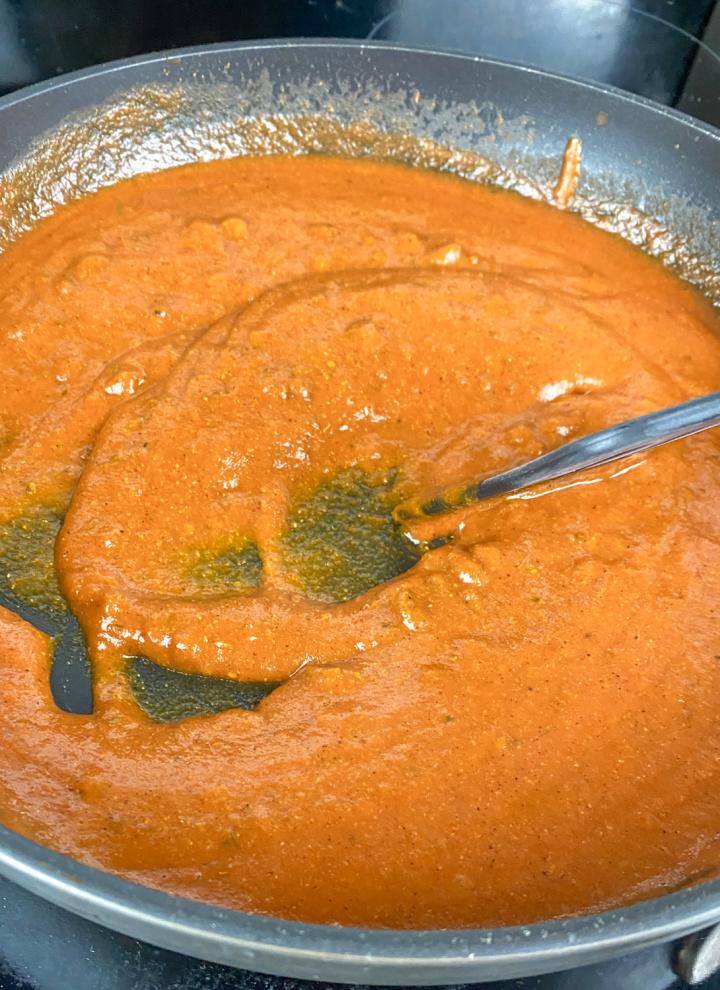 Enchilada sauce simmering in skillet