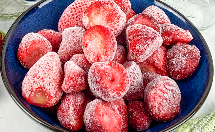 frozen strawberries in blue bowl