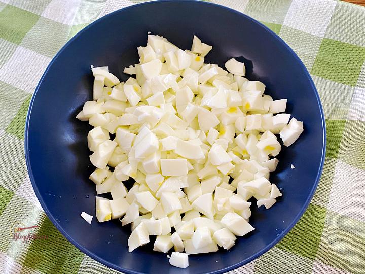 chopped egg whites in blue bowl