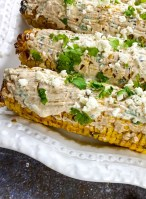 Mexican Street Corn platter with toppings next to it