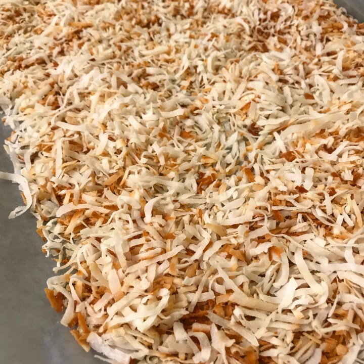 toasted coconut cooling on tray