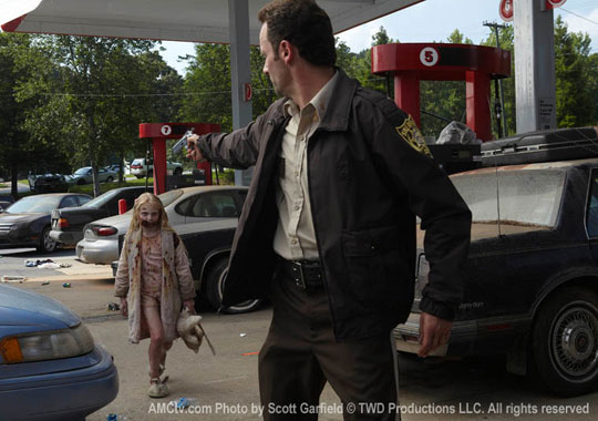Rick about to shoot girl zombie