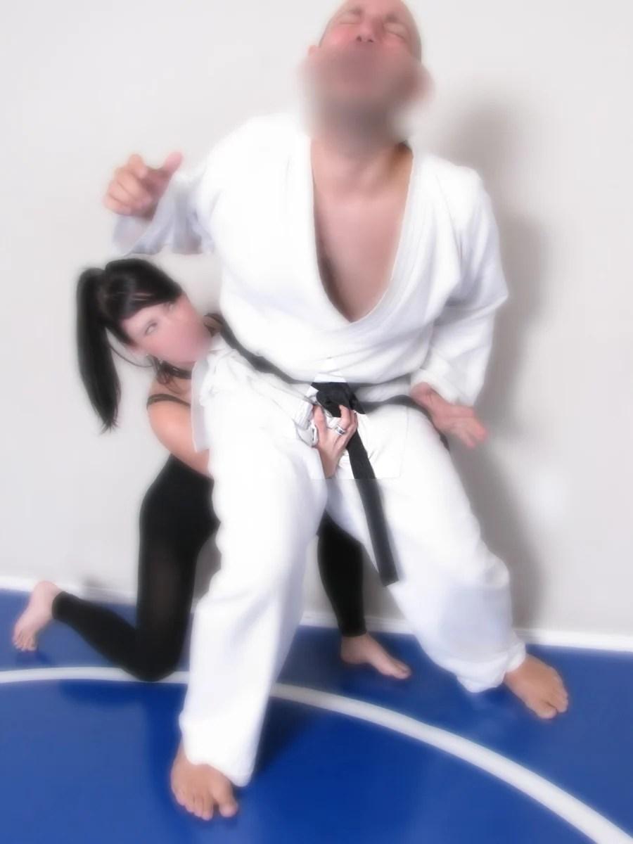 Woman Karate Kicks Man