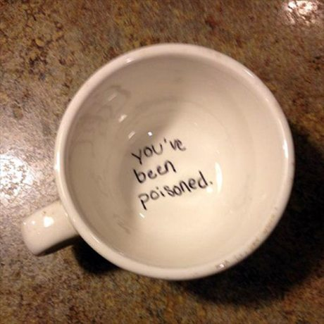 """Writing in the bottom of a Coffee Cup: """"You've been poisoned."""""""