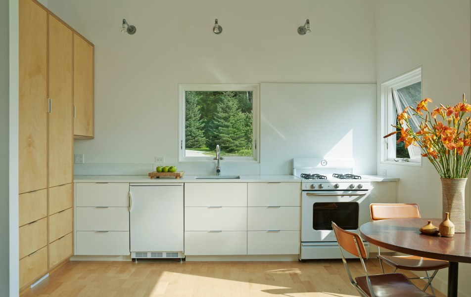 Tiny home kitchen with square Marvin window