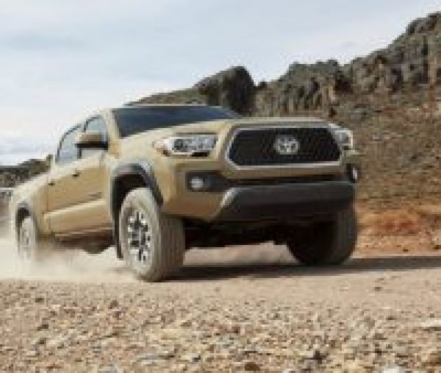 Gold  Toyota Tacoma Front Side View