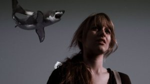 It's a Sharknado attack on Claudia (Aubrey Peeples)