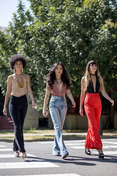 3 models walking side by side wearing flares