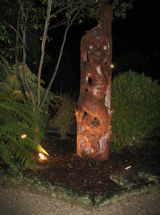 wooden maori totem pole