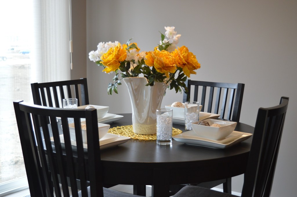 A dining table with fresh flowers