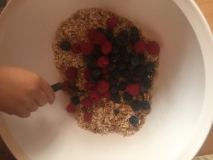 mixing berries into oatmeal mix