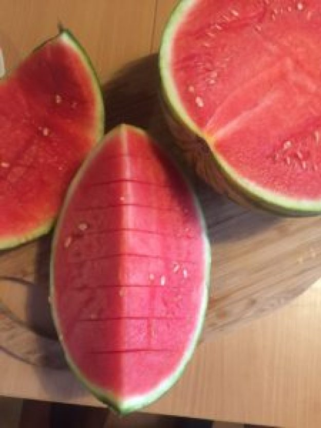 watermelon cut in half and sliced