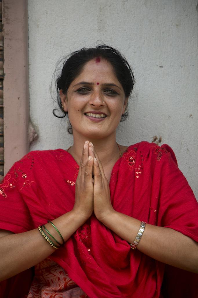 A Nepalese woman greeting Namaste