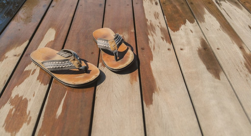 a pair of flip flops on a deck