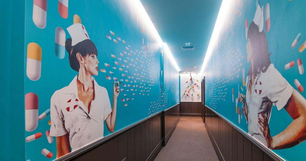 Corridor of Exhibitionist hotel with mural