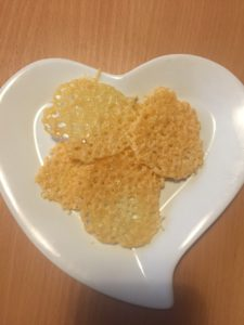 baked cheese crisps on a heart shaped plate