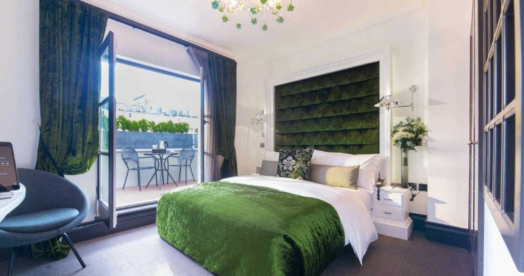 Exhibitionist hotel room in green velvet