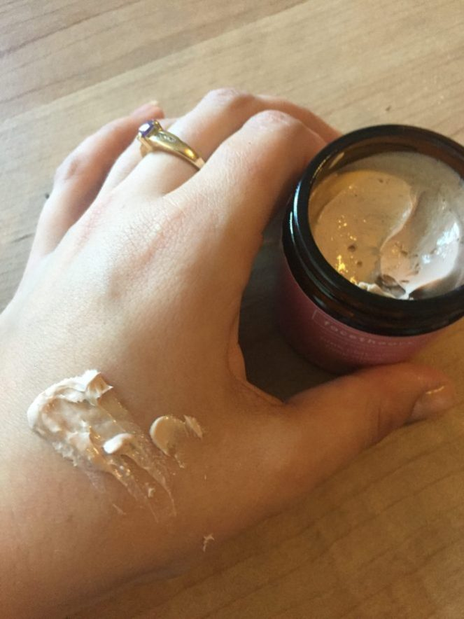 Face Theory Pink clay mask on hand