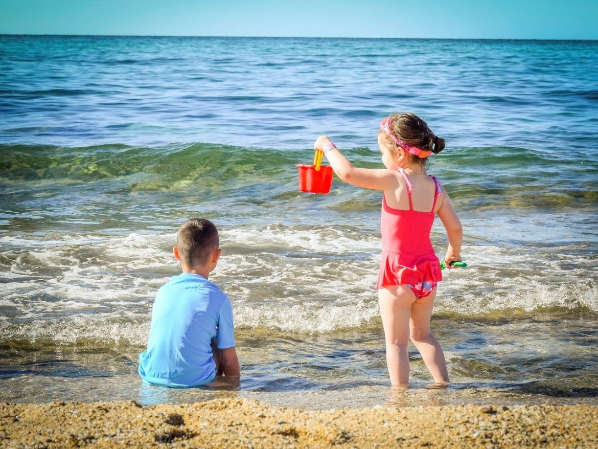 kids playing at the beach on holidays