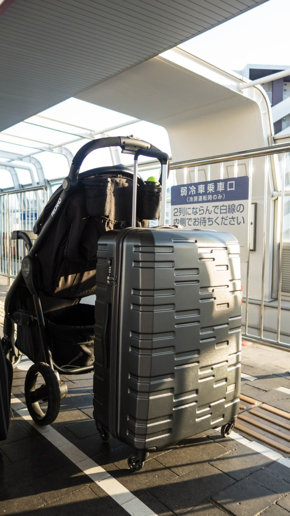 suitcase with BabyBjorn Travel Cot Light inside