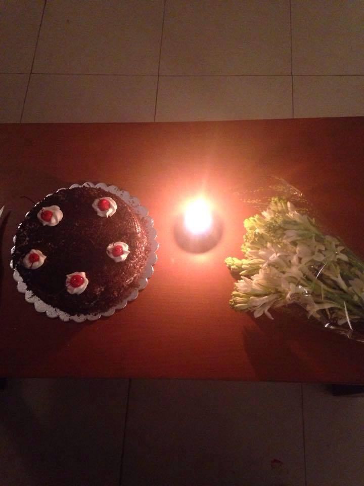 She shopped for stuff before her b'day, so this just a small surprise of cake, candle and tuberose(her favourite).