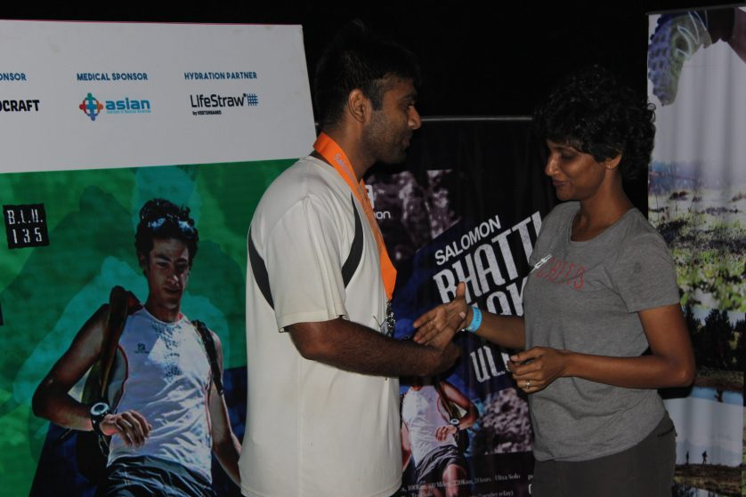 Receiving the medal from Kavitha, the RD.