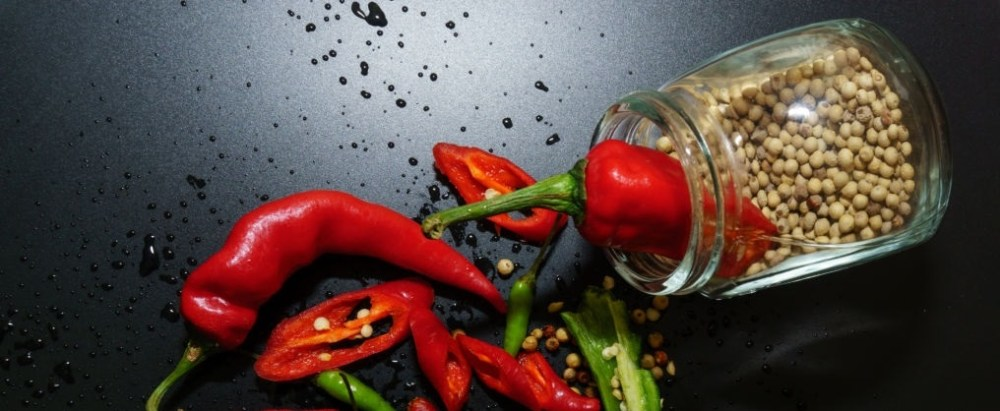 Close-Up Of Chili Peppers Over Black Background