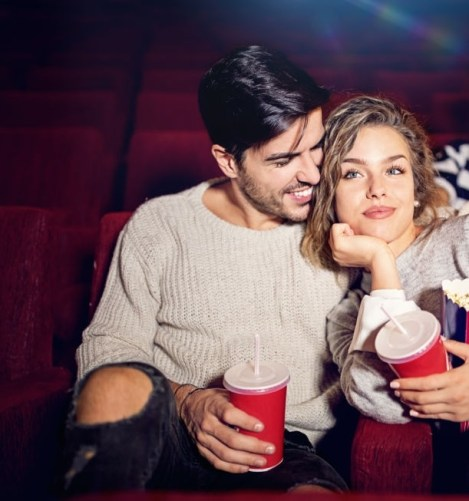 Couple is watching romantic movie in the cinema theater
