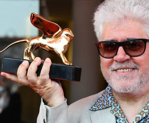 Spanish director Pedro Almodovar kisses his award on August 29, 2019 after receiving a Golden Lion for lifetime achievement during a ceremony at the 76th Venice Film Festival at Venice Lido. (Photo by Vincenzo PINTO / AFP) (Photo credit should read VINCENZO PINTO/AFP/Getty Images)