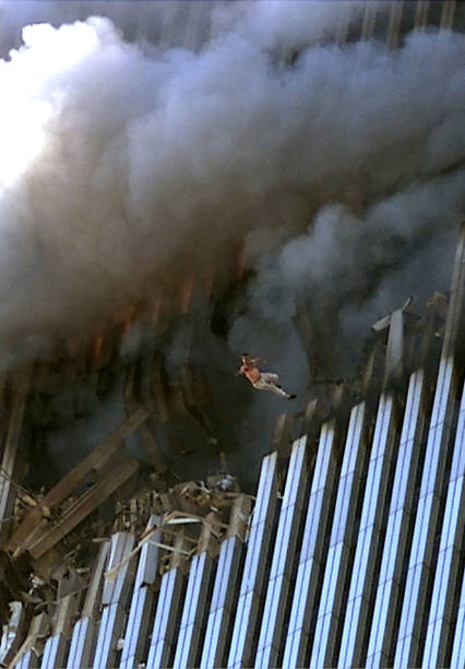 394263 22: (PUERTO RICO AND GERMANY OUT) A man leaps to his death from a fire and smoke filled Tower One of the World Trade Center September 11, 2001 in New York City after terrorists crashed two hijacked passenger planes into the twin towers. (Photo by Jose Jimenez/Primera Hora/Getty Images)