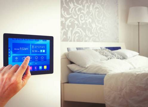 Person controlling home using home automation