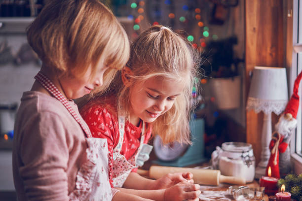 Little Girls Kneading Dough for Christmas Cookies