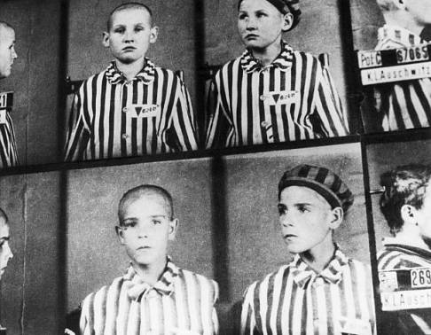 circa 1940: Mugshots show boys interned at the Auschwitz concentration camp, Auschwitz, Poland, World War II. The boys wear striped uniforms. (Photo by Hulton Archive/Getty Images)