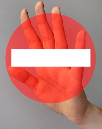 One female hand is making a stop sign.