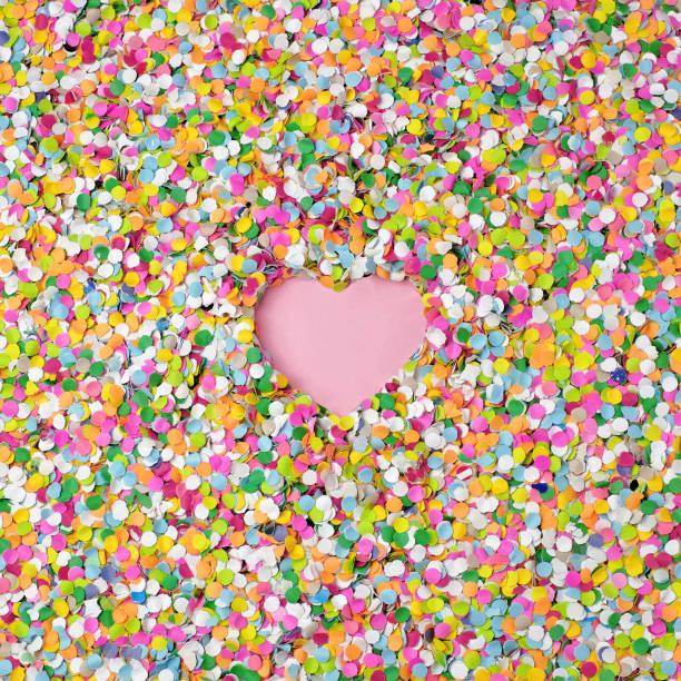 field of confetti with negative heart shape in center
