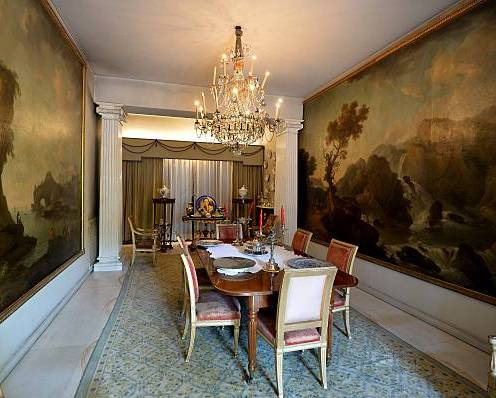 A picture shows the dining room of late Italian movie star Alberto Sordi during an opening day to the press of the house of the actor on June 15, 2015, in central Rome. The villa of the actor (1920-2003), where he lived from 1958 to 2003, will be turned into a cultural museum dedicated to Sordi's memory. AFP PHOTO / TIZIANA FABI (Photo credit should read TIZIANA FABI/AFP via Getty Images)