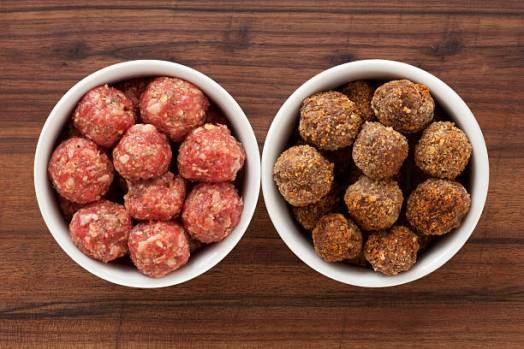 Top view of two white bowls with meatballs. Raw on the left and fried on the right for food processing concept