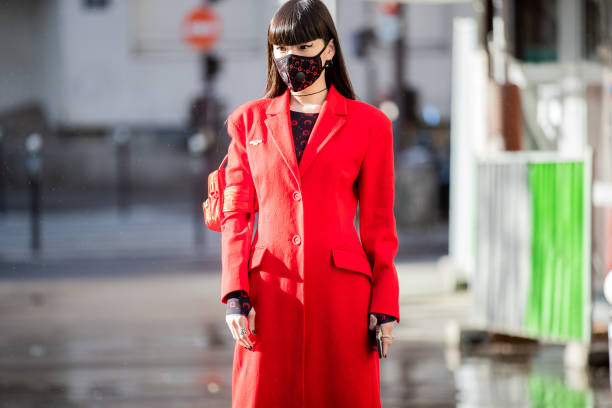 PARIS, FRANCE - FEBRUARY 25: Kozue Akimoto is seen wearing face mask, red coat outside Marine Serre during Paris Fashion Week - Womenswear Fall/Winter 2020/2021 : Day Two on February 25, 2020 in Paris, France. (Photo by Christian Vierig/Getty Images)