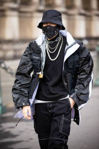 PARIS, FRANCE - FEBRUARY 29: A guest, wearing a black top, black jacket, black pants, black hat and black studded mask, is seen outside Vivienne Westwood, during Paris Fashion Week - Womenswear Fall/Winter 2020/2021 : Day Six on February 29, 2020 in Paris, France. (Photo by Claudio Lavenia/Getty Images)