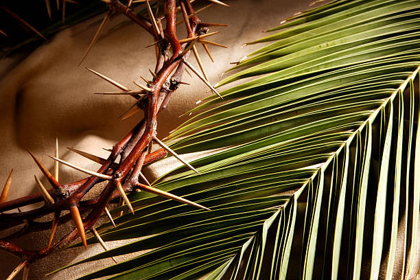 A crown of thorns and a palm branch.