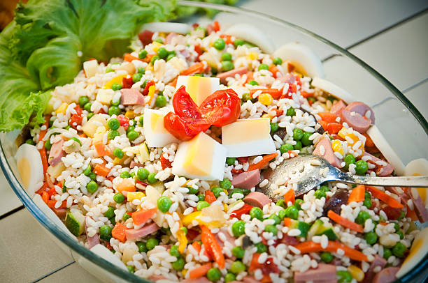 """rice salad with tomatoes, eggs, peas, frankfurt, wusterl, salad"""