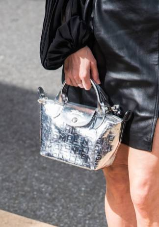 NEW YORK, NY - SEPTEMBER 07: Actress Linda Cardellini, handbag detail, is seen arriving to the Longchamp SS20 Runway Show at Hearst Plaza, Lincoln Center during NYC Fashion Week on September 07, 2019 in New York City. (Photo by Gilbert Carrasquillo/GC Images)