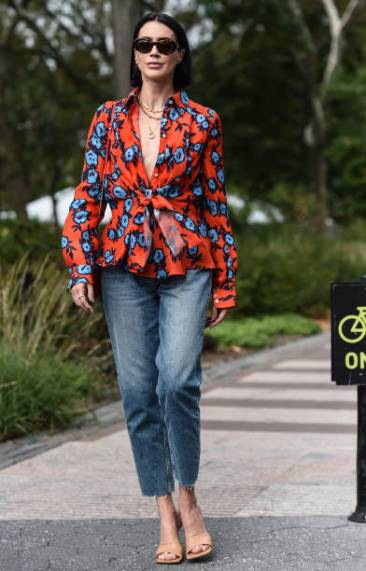 NEW YORK, NEW YORK - SEPTEMBER 09: Brittany Xavier is seen wearing a red and blue floral top and blue jeans outside the Carolina Herrera show during New York Fashion Week S/S20 on September 09, 2019 in New York City. (Photo by Daniel Zuchnik/Getty Images)