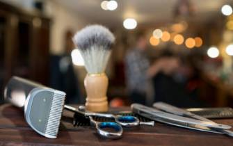 Close-up on a set of shaving tools at a barber shop - grooming kit concepts