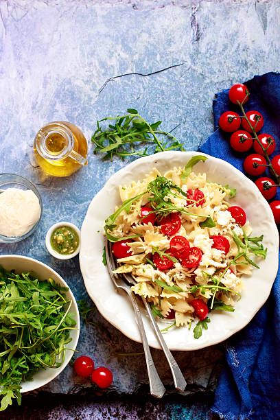 Pasta salad with arugula pesto and cherry tomatoes