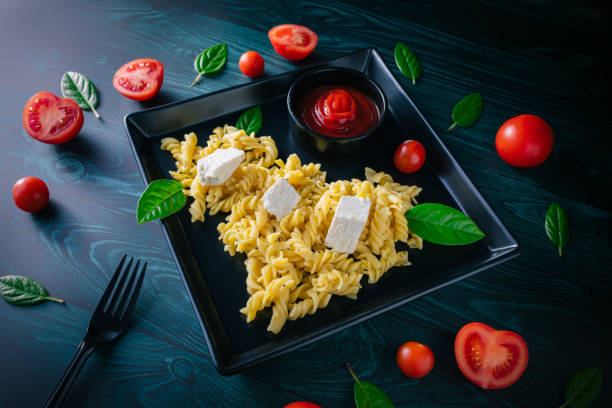 Home made fusilli pasta with cherry tomatoes and feta cheese