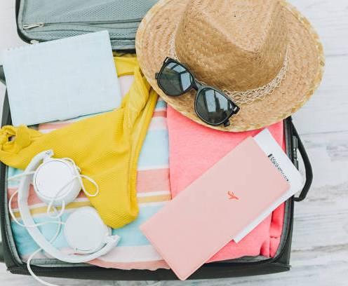 open luggage wirh summer travel items