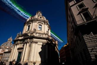 The Italian Air Force aerobatic unit Frecce Tricolori (Tricolor Arrows) spreads smoke with the colors of the Italian flag over the Santissimo Nome di Maria al Foro Traiano church in the city of Rome on June 2, 2019 as part of the Republic Day ceremony. (Photo by Laurent EMMANUEL / AFP) (Photo credit should read LAURENT EMMANUEL/AFP via Getty Images)