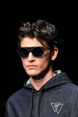 MILAN, ITALY - JUNE 15: A model, sunglasses detail, walks the runway at the Emporio Armani fashion show during the Milan Men's Fashion Week Spring/Summer 2020 on June 15, 2019 in Milan, Italy. (Photo by Jacopo Raule/Getty Images)